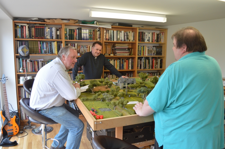 Richard Clarke (seated) explains the basics of the rules to Neil & Mike
