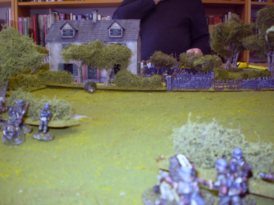 The Germans are shocked to see one of their squads wiped out (note the body in the field - the only remaining figure)
