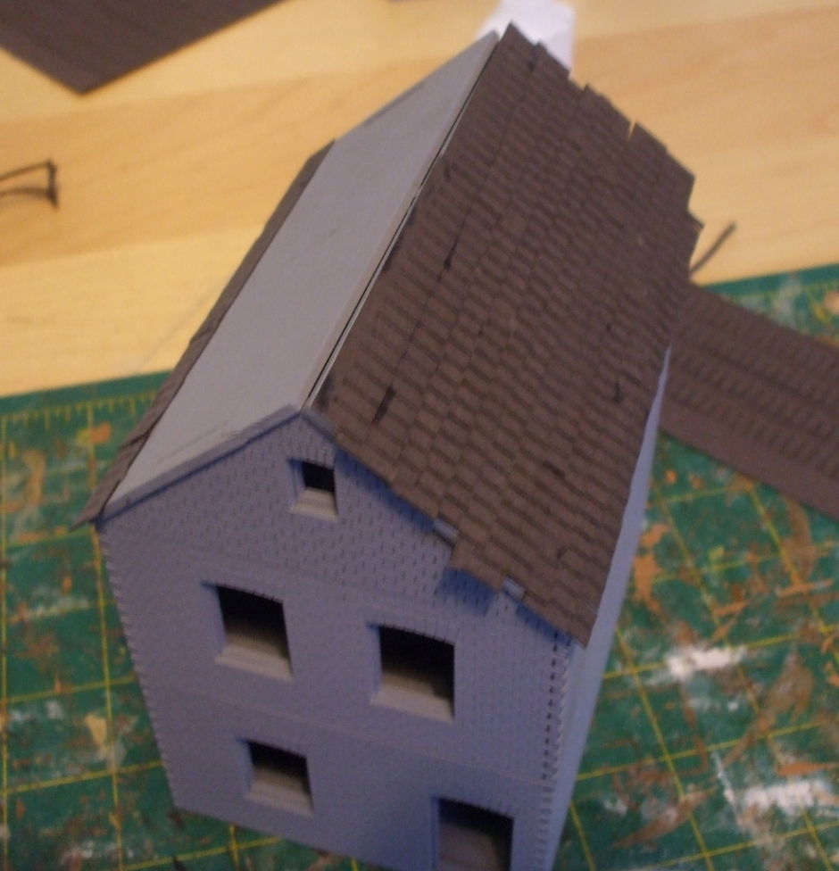 The basic build completed and some of the roof tiles glued on